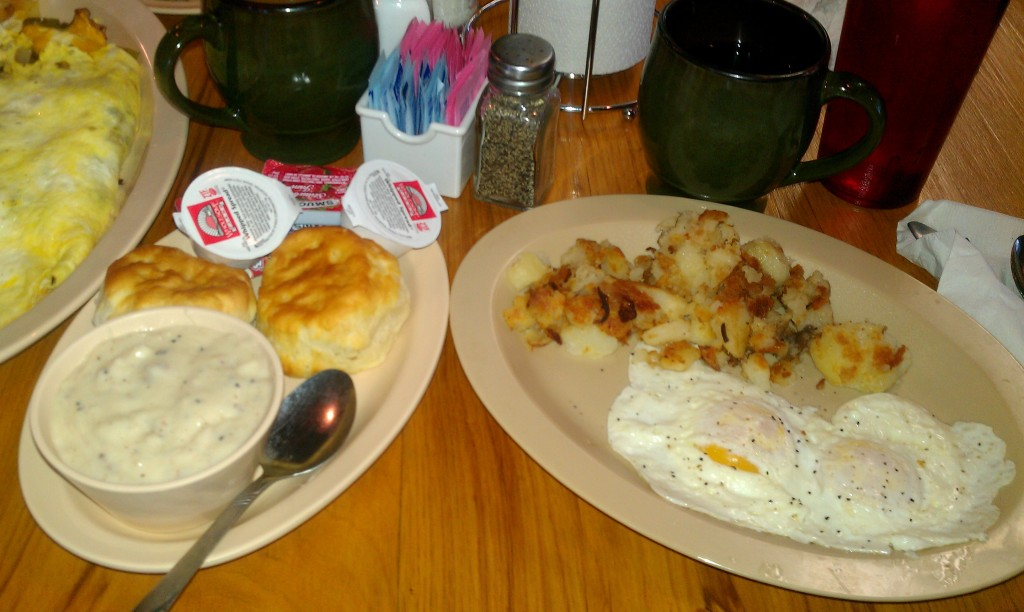 Biscuit and gravy, fried potatoes and eggs over medium from Terri Ann's.
