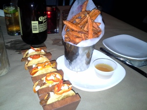 Taquitos and sweet potato fries at Mussel & Burger Bar.