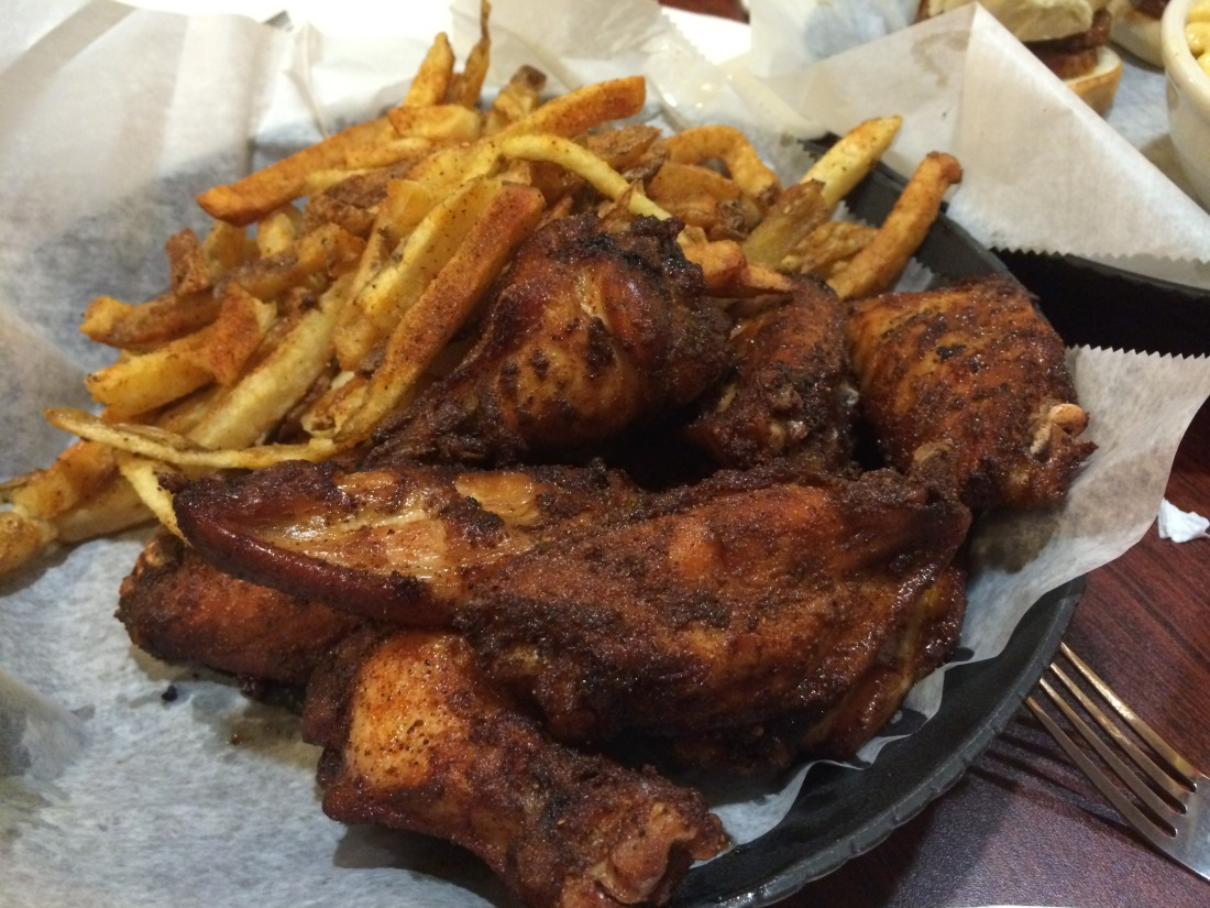 An order of 10 wings and a medium fry at Momma's Mustard, Pickles & BBQ.