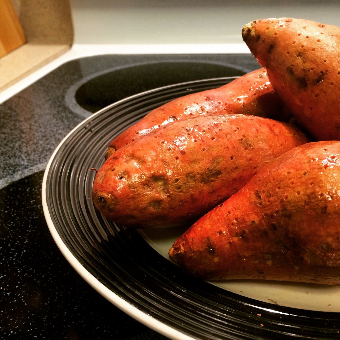 A few sweet potatoes waiting for their aluminum foil coat.
