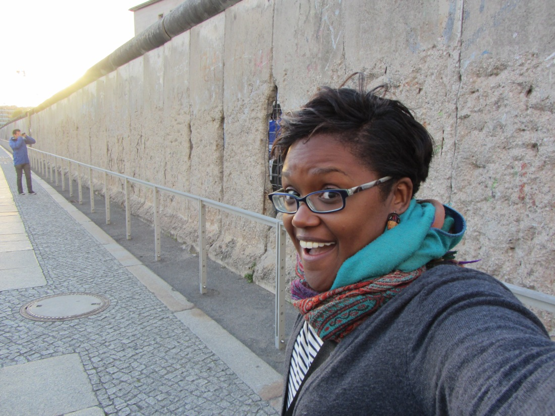 A poor attempt at a selfie in front of a remaining piece of the Berlin Wall.